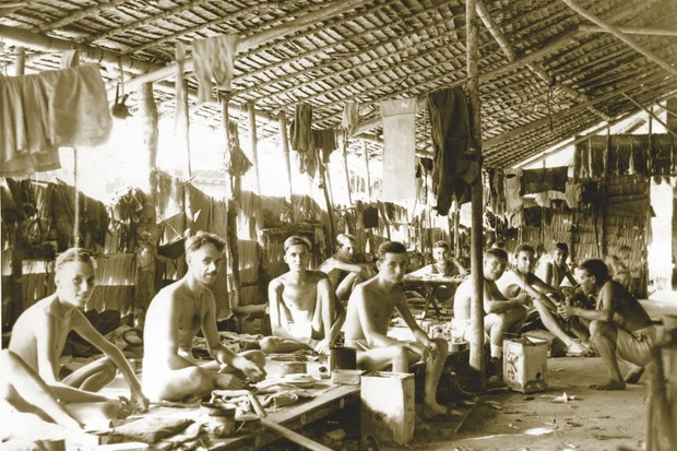Australian PoWs in a camp at the Sumatran city of Pekanbaru, c1945. More than 80,000 forced labourers, including PoWs, died during the construction of Sumatran railway, most the victims of disease, starvation and maltreatment. (Photo by State Library of Victoria)