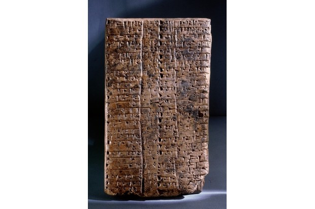 c2044 BC, Sumeria, Ancient Iraq: Ur III clay administrative tablet, impressed with the scribes seal, which depicts a goddess leading a worshipper and the text Ur Gigir, scribe, son of Barran. The main text on the reverse (pictured) lists ploughmen employed by the state with the quantities of land assigned to them as wages. (Photo by Werner Forman/Universal Images Group/Getty Images)