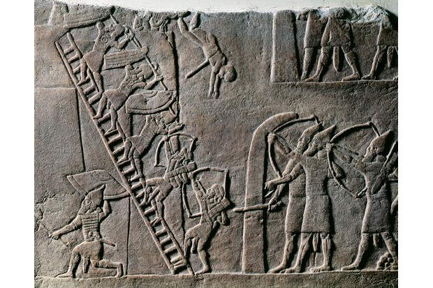 A seventh-century BC Assyrian relief shows soldiers storming an Egyptian city, as the power of Egypt's once mighty pharaohs waned. (Photo by Bridgeman)