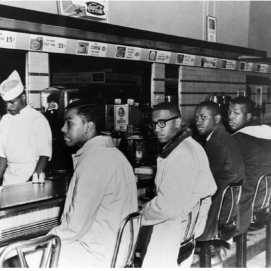 Four black students in Greensboro, North Carolina, hold the first sit-in (Photo by Corbis)