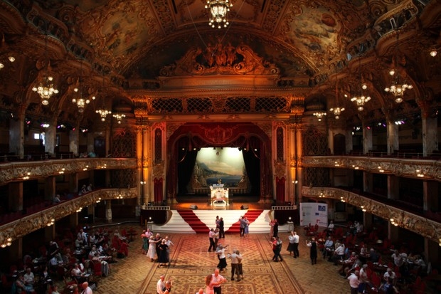 Holidaymakers dance to the sound of the Blackpool Tower Ballroom's famous Wurlitzer organ in 2011. The ballroom, designed by the English architect Frank Matcham, was expanded to its current scale in 1899. (Photo by Christopher Furlong/Getty Images)