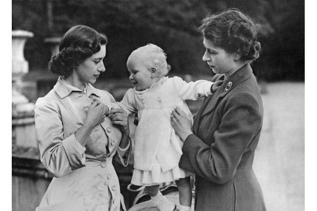 Princess Margaret (left) with her sister, Queen Elizabeth II, and her baby niece Princess Anne, c1951. (Photo by Central Press/Hulton Archive/Getty Images)