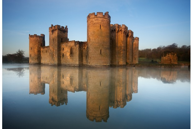 The symmetry of Bodiam Castle is designed to be reflected perfectly in the moat. (Photo by Getty Images)