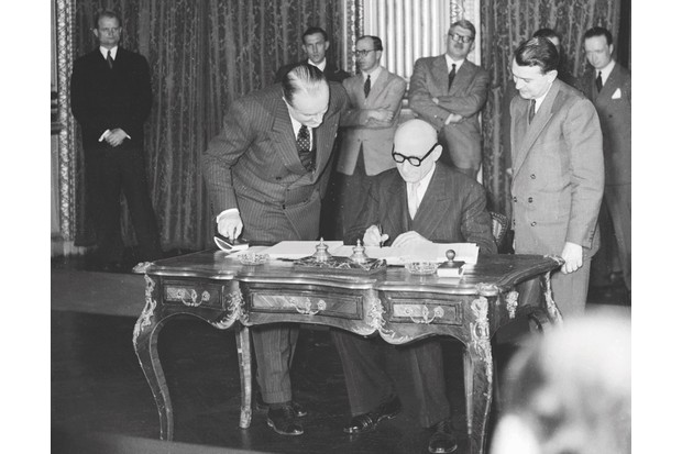 "French foreign minister Robert Schuman signs the 1951 treaty creating the European Coal and Steel Community – forerunner to the EU, and a project he described as ""a leap into the unknown"". (Photo credit: AFP/Getty Images)"