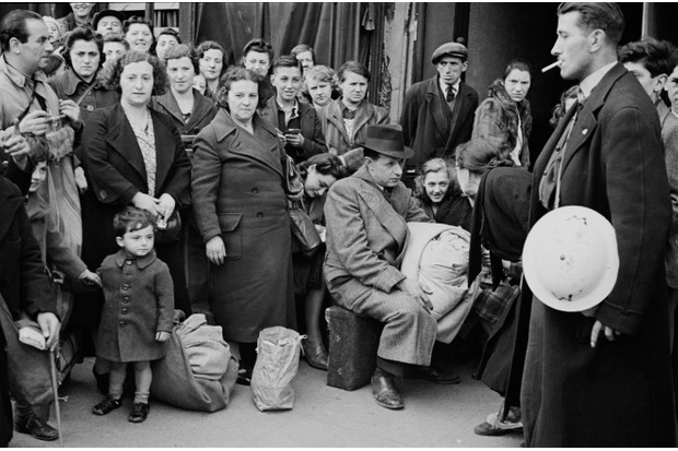 The Second World War damaged housing stock (Coventry, for example, lost one third of its homes in the Blitz), but also the state was unable to build new homes quickly enough due to the short supply of building materials. Pictured are east Londoners displaced by bombing raids in September 1940. (Photo by Bert Hardy/Picture Post/Hulton Archive/Getty Images)