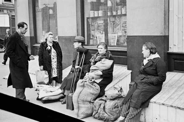 In 1945 there were two million more 'potential' households than actual homes, in part exacerbated by the wartime damage to housing stock (Coventry, for example, lost one third of its homes in the Blitz). Here, displaced people in east London wait on the street. (Photo by Bert Hardy/Picture Post/Hulton Archive/Getty Images)