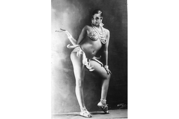 Entertainer Josephine Baker, in costume for her famous 'banana dance'. When Baker debuted her banana skirt dance in 1926, she became an overnight sensation. (Photo by Walery/Getty Images)