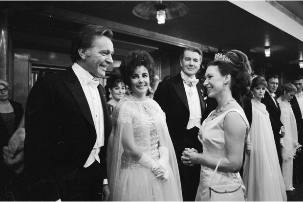 c1967: Princess Margaret chatting to Richard Burton and his wife Elizabeth Taylor, with Sir Michael Redgrave behind them, at the 1967 Royal Film Performance of the film 'The Taming Of The Shrew', starring Taylor and Burton, at the Odeon Theatre, Leicester Square, London. (Photo by Douglas Miller/Keystone/Getty Images)