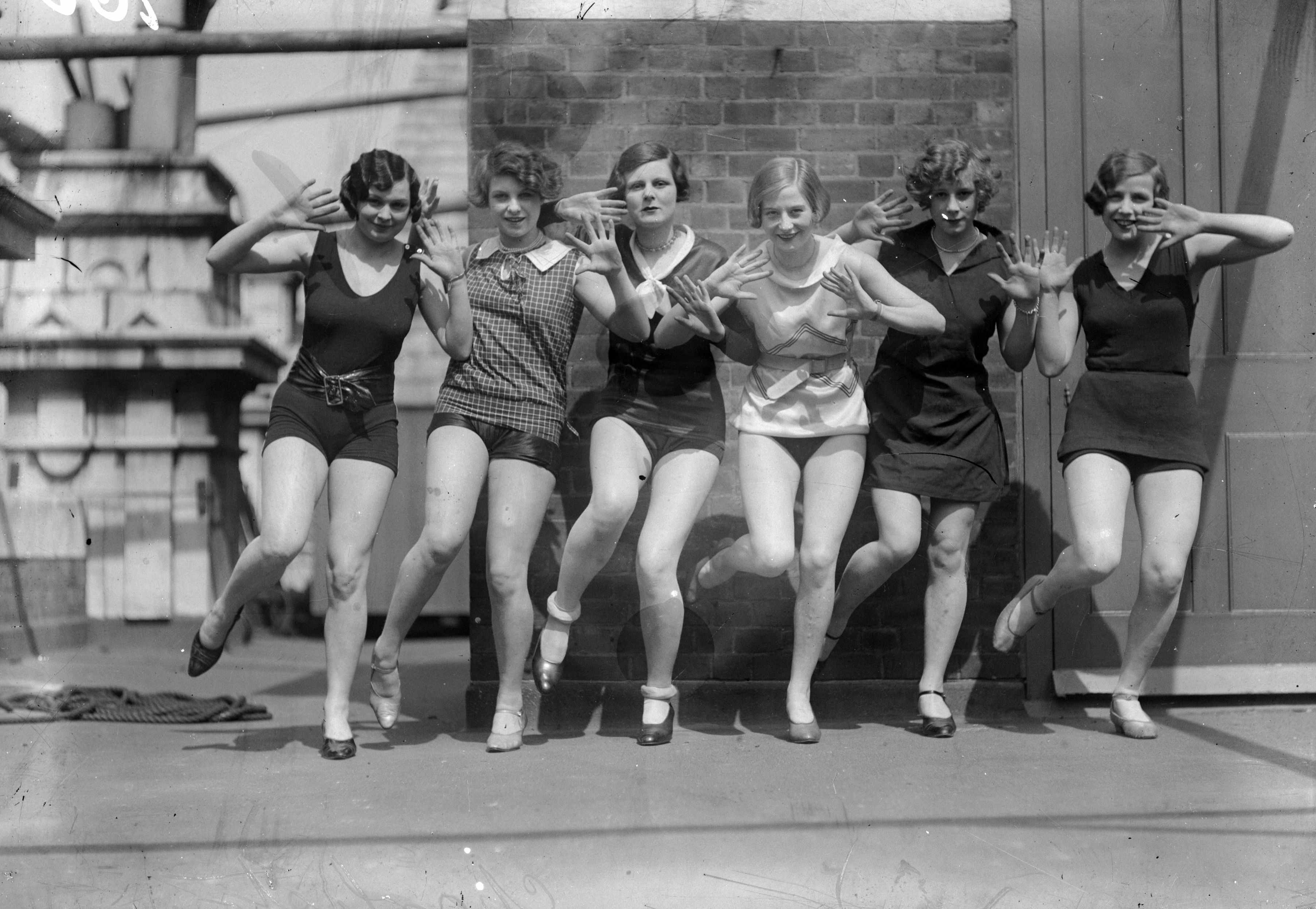Dancers demonstrate the Charleston, c1926. The dance is often associated with 'flappers' – newly enfranchised women with bobbed hair, short skirts and supposedly looser morals – and characterised by frenetic up and down movements and swivelling, akimbo limbs. (Photo by General Photographic Agency/Getty Images)