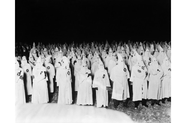 A gathering of the Ku Klux Klan in Florida, 1923. The Klan provides a vivid example of how social movements work together with electoral politics by threatening politicians and candidates with loss of votes, says Linda Gordon. (Picture by Bettmann/Getty Images)