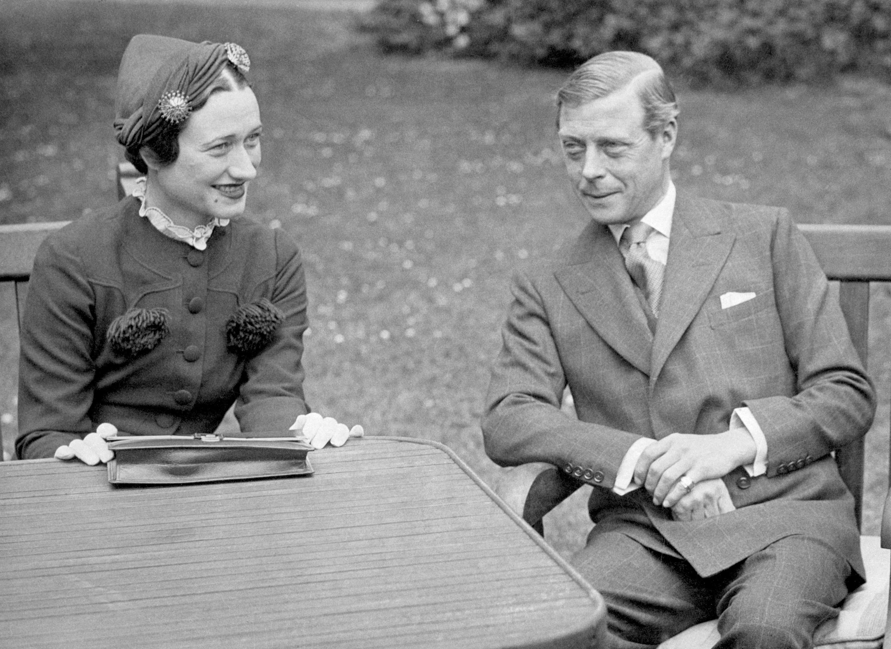(Original Caption) 1937- France: Edward VIII, Duke of Windsor, sits with his wife Wallis Simpson at the Chateau de Cands in France. Photo shows a close-up view of the couple.