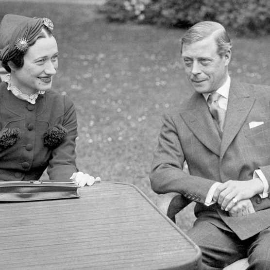 Edward VIII, Duke of Windsor, sits with his wife, Wallis Simpson, at the Chateau de Cands in France, 1937. (Photo by Bettmann via Getty Images)