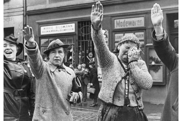 Residents of a Sudetenland town greet German troops in October 1938. The Munich agreement had seen Britain giving its assent to the Nazi absorption of German-speaking areas of Czechoslovakia. (Photo by Getty Images)