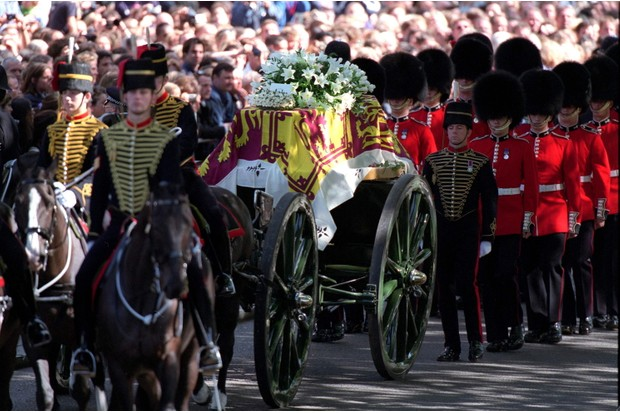 The coffin of Diana, Princess of Wales, being carried through the streets of London on its journey to Westminster Abbey. (Photo by Tim Graham/Getty Images)