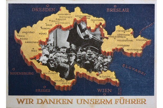 """""""We thank our leader,"""" declares a German propaganda postcard celebrating Nazi victory in the Sudetenland, December 1938. (Photo by Michael Nicholson/Corbis via Getty Images)"""