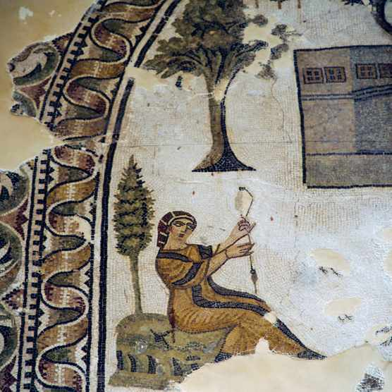 A fourth to fifth-century AD Roman mosaic shows a woman spinning. The household was considered a woman's natural environment; the political arena certainly was not. (Photo by DeAgostini/Getty Images)