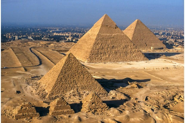 Pyramids built by the pharaohs Khufu, Khafre and Menkaure tower over the outskirts of Cairo. These awesome edifices were constructed three millennia before the city's foundation. (Photo by Getty Images)