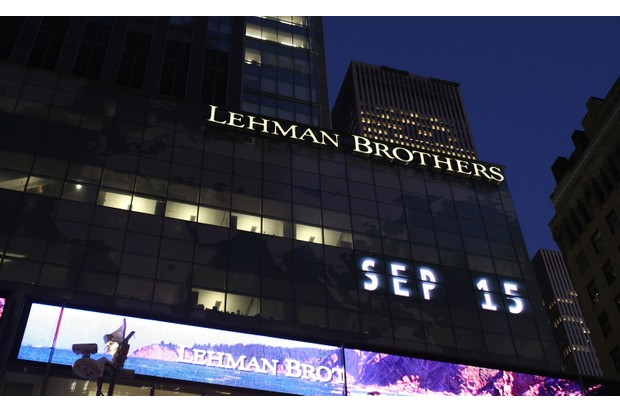 The Lehman Brothers' name is illuminated at the headquarters of Lehman Brothers Holdings Inc. in New York City, 15 September 2008. (Photo by Mario Tama/Getty Images)