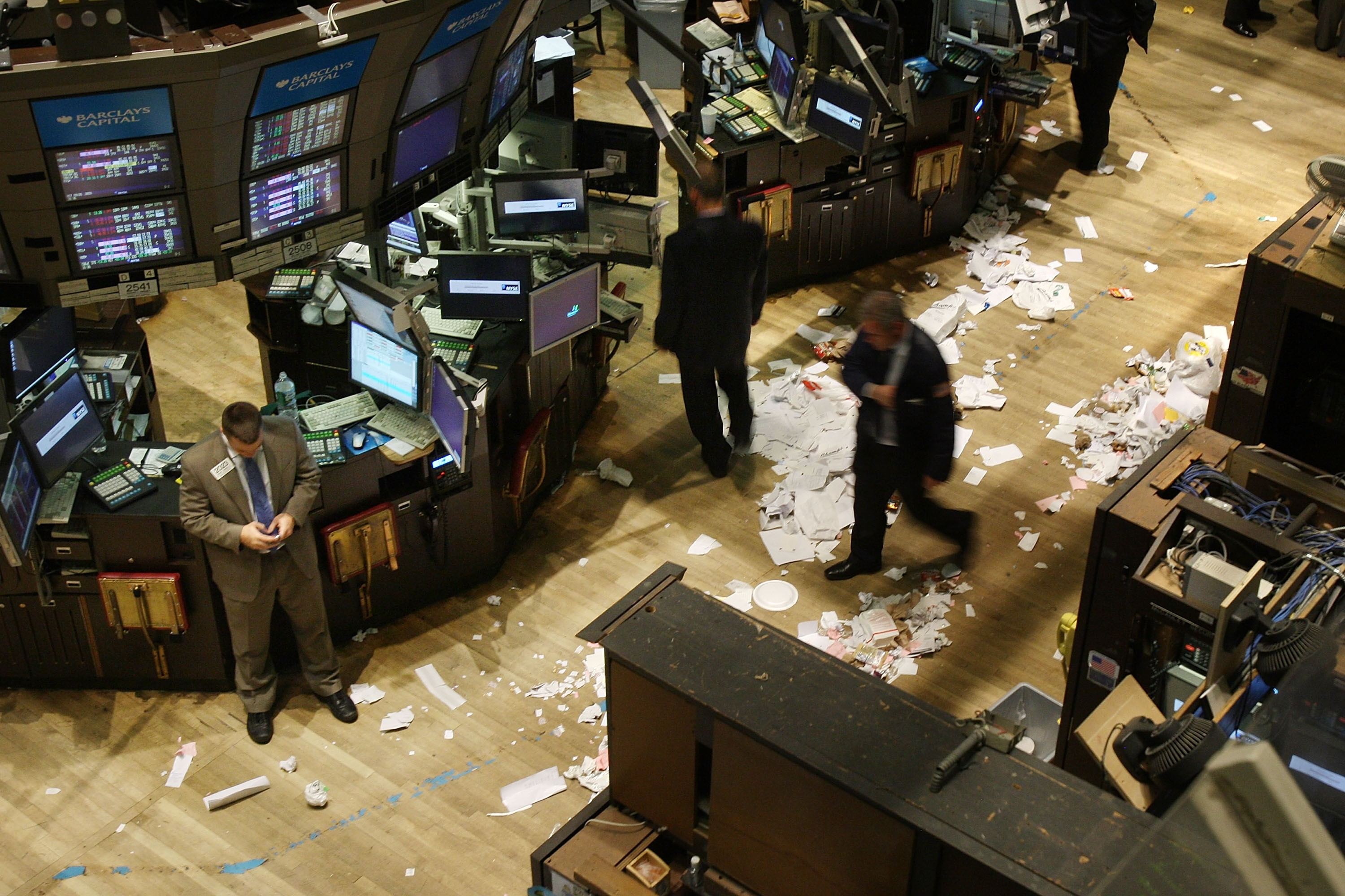 Traders on the floor of the New York Stock Exchange after the closing bell on 29 September 2008. A record 778 points were wiped off the Dow Jones that day, as the 2008 financial crisis pushed the world's banking system to the edge of collapse. (Photo by Spencer Platt/Getty Images)