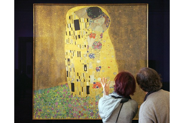 Visitors to the Belvedere Museum, Vienna, look at Gustav Klimt's painting 'Der Kuss' (The Kiss), painted between 1907–8). AFP PHOTO / DIETER NAGL (Photo by DIETER NAGL/AFP/Getty Images)