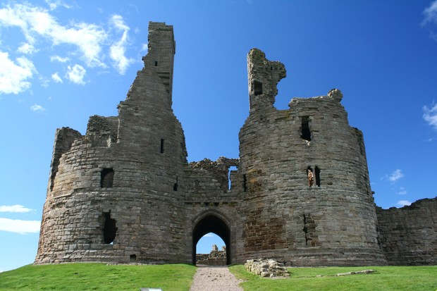 The ruins of Dunstanburgh Castle, Northumberland. (Photo by Martin Brewster via Getty Images)