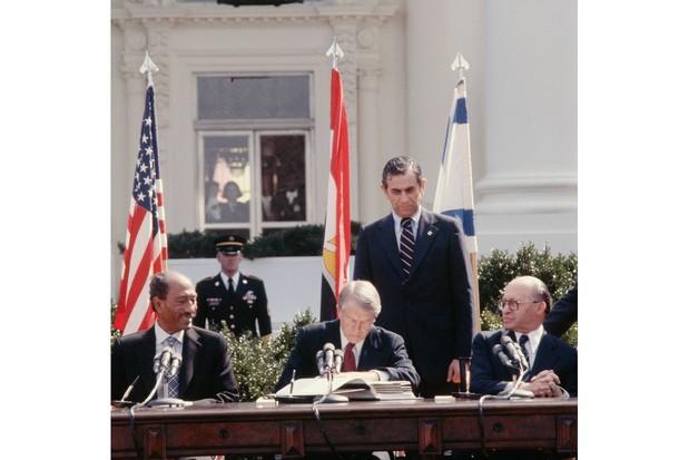Jimmy Carter, Anwar Sadat and Menachem Begin sign an Arab-Israeli peace treaty in March 1979