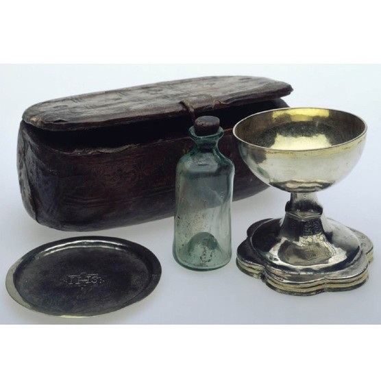 Travelling Mass set, c1535, consisting of a silver-gilt chalice; a paten (Communion plate) and a glass bottle for wine, with a leather box in which to carry them. (Photo by Museum of London/Heritage Images/Getty Images)