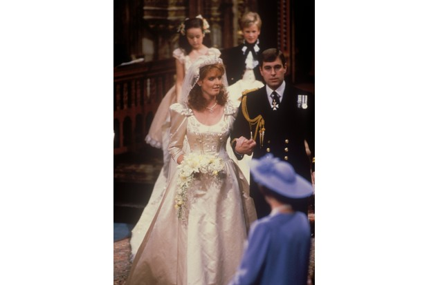 For her wedding to Prince Andrew, Duke of York in 1986, Sarah Ferguson chose Italian silk because it was better able to support the embroidery than English silk, says Carolyn Harris. (Photo by John Shelley Collection/Avalon/Getty Images)