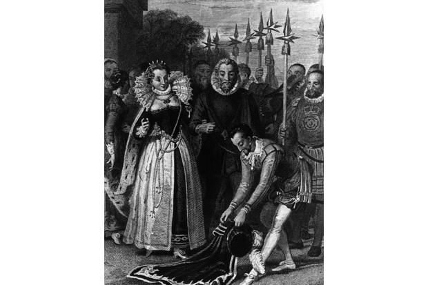 A depiction of the popular story of Sir Walter Ralegh laying his cloak across a puddle for Queen Elizabeth I. Ralegh came from a modest background but ended up as captain of the queen's guard. (Photo by Hulton Archive/Getty Images)