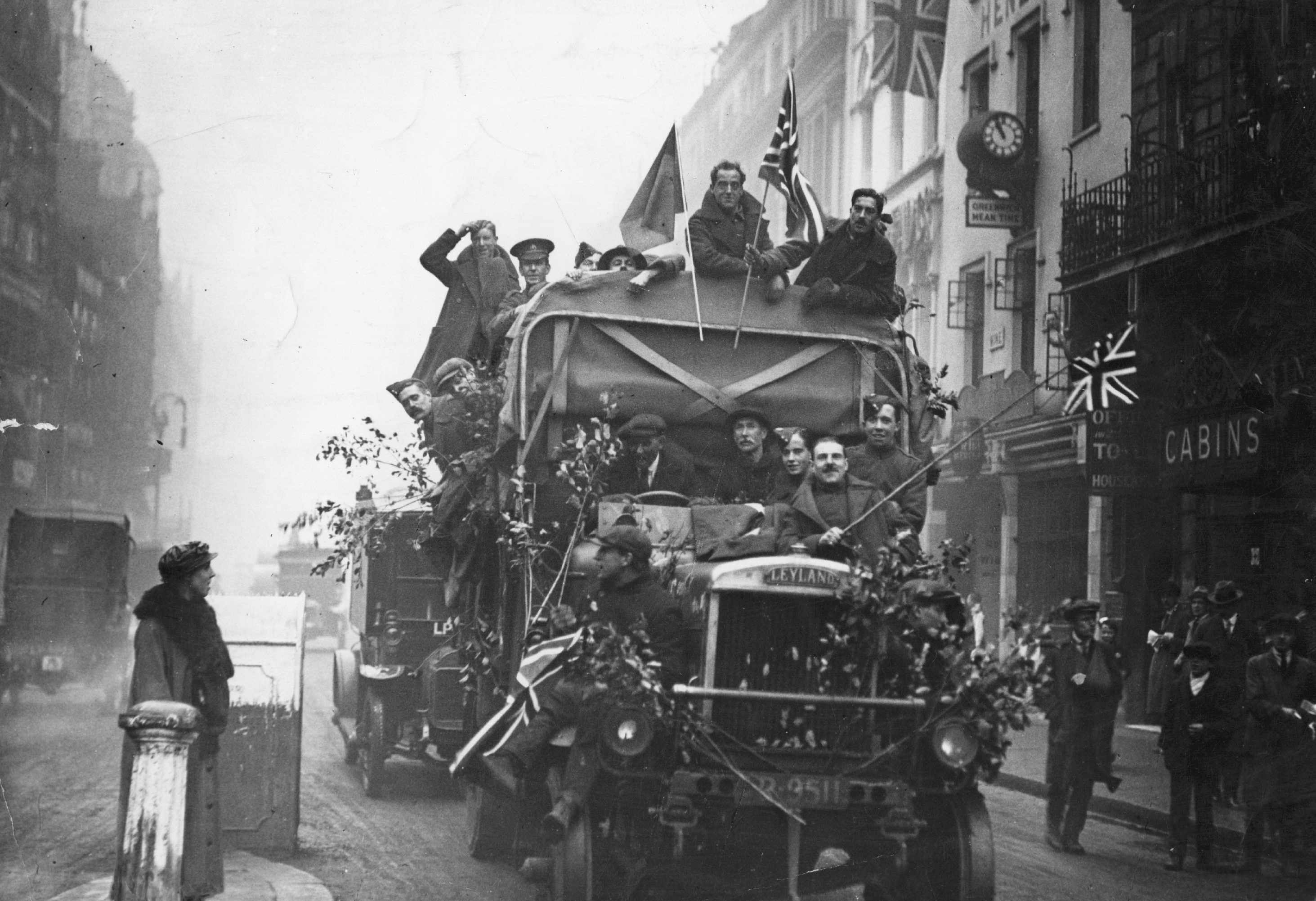 11th November 1918: An army lorry in a London street on Armistice Day, carrying jubilant passengers. (Photo by Topical Press Agency/Getty Images)