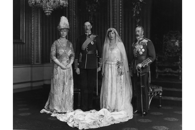 Queen Mary and King George V, with their daughter Mary, the Princess Royal, and Viscount Lascelle, 6th Earl of Harewood, on their wedding day in 1922. The princess's decision to marry an Englishman rather than a foreign prince was extremely popular. (Photo by W. & D. Downey/Getty Images)