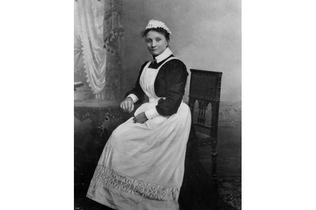 circa 1890: A maid in a frilled cap, long white apron and stiff white collar cuffs. (Photo by Downey/W. and D. Downey/Getty Images)