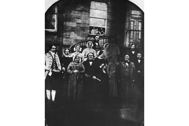 The domestic staff at Erdigg Hall, the home of the Yorke family in Wrexham, North Wales, 1852. They are head gardener James Phillips, coachman Edward Humphries, laundry maid Elizabeth Alford, dairy maid Mary Davies, head housemaid Ruth Jones, under gardener William Price, footman William Stephenson, head nurse Eliza Rogers, cook and housekeeper Mrs Webster, butler Thomas Murray, lady's maid Elizabeth Hale, under nurse Sarah Evans, carpenter Thomas Rogers and hall boy Edward Davies. From a daguerrotype. (Photo by Hulton Archive/Getty Images)