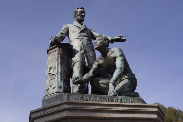 "The bronze statue in Washington DC celebrating Abraham Lincoln's emancipation of slaves shows the 16th president standing over a shackled African American. Lincoln is ""one of the towering figures in the story that Americans tell about themselves,"" writes Lucy Worsley. (Photo by Andrew Lichtenstein/Corbis via Getty Images)"