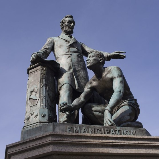 """The bronze statue in Washington DC celebrating Abraham Lincoln's emancipation of slaves shows the 16th president standing over a shackled African American. Lincoln is """"one of the towering figures in the story that Americans tell about themselves,"""" writes Lucy Worsley. (Photo by Andrew Lichtenstein/Corbis via Getty Images)"""