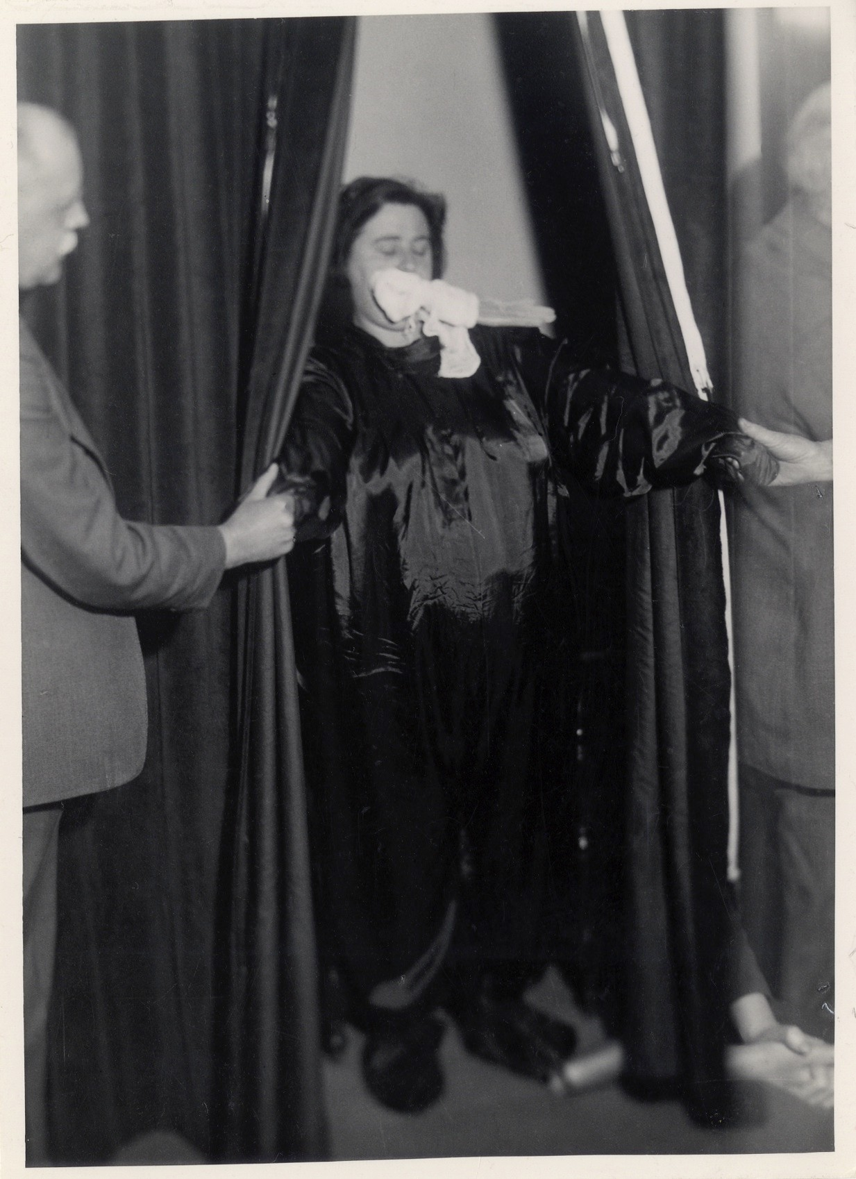 Helen Duncan, a 20th-century medium and spiritualist, allegedly summoned spirits draped in 'ectoplasm' – organic matter emitted from her body. In the 1930s she was denounced as a fraud, and in 1944 prosecuted under the 1735 Witchcra Act, which forbade conjuring spirits. (Photo courtesy of Ashmolean Museum/University of London)