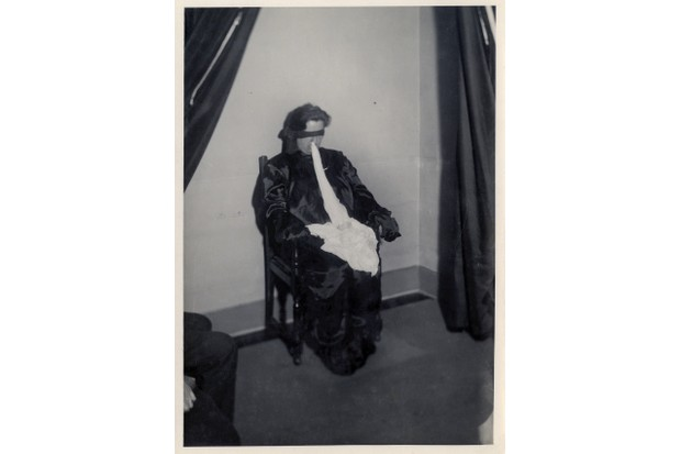 Not everyone was convinced that Duncan's performances were genuine. To examine her powers under laboratory conditions, photographer Harry Price dressed her in an all-enclosing satin séance suit and blindfolded her. (Photo courtesy of Ashmolean Museum/University of London)