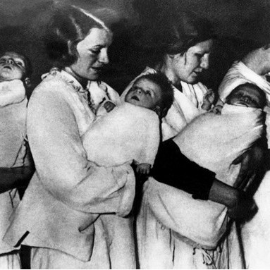 German women carrying children believed to be part of the Lebensborn programme, which aimed to raise the birth rate of blonde-haired, blue-eyed 'Aryan' children through interbreeding. (Photo by Keystone-France/Gamma-Keystone via Getty Images)