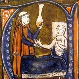 A doctor examines a patient's urine in an illustration from the 13th century. Uroscopy, the study of urine, was one of the medieval physician's most effective tools, and is still employed today. (Photo by Bridgman Art Library)