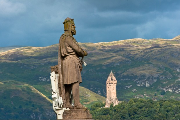 Statues of Robert the Bruce together with the Wallace monument seen from Stirling castle, Scotland, UK. (Photo by: Education Images/UIG via Getty Images)