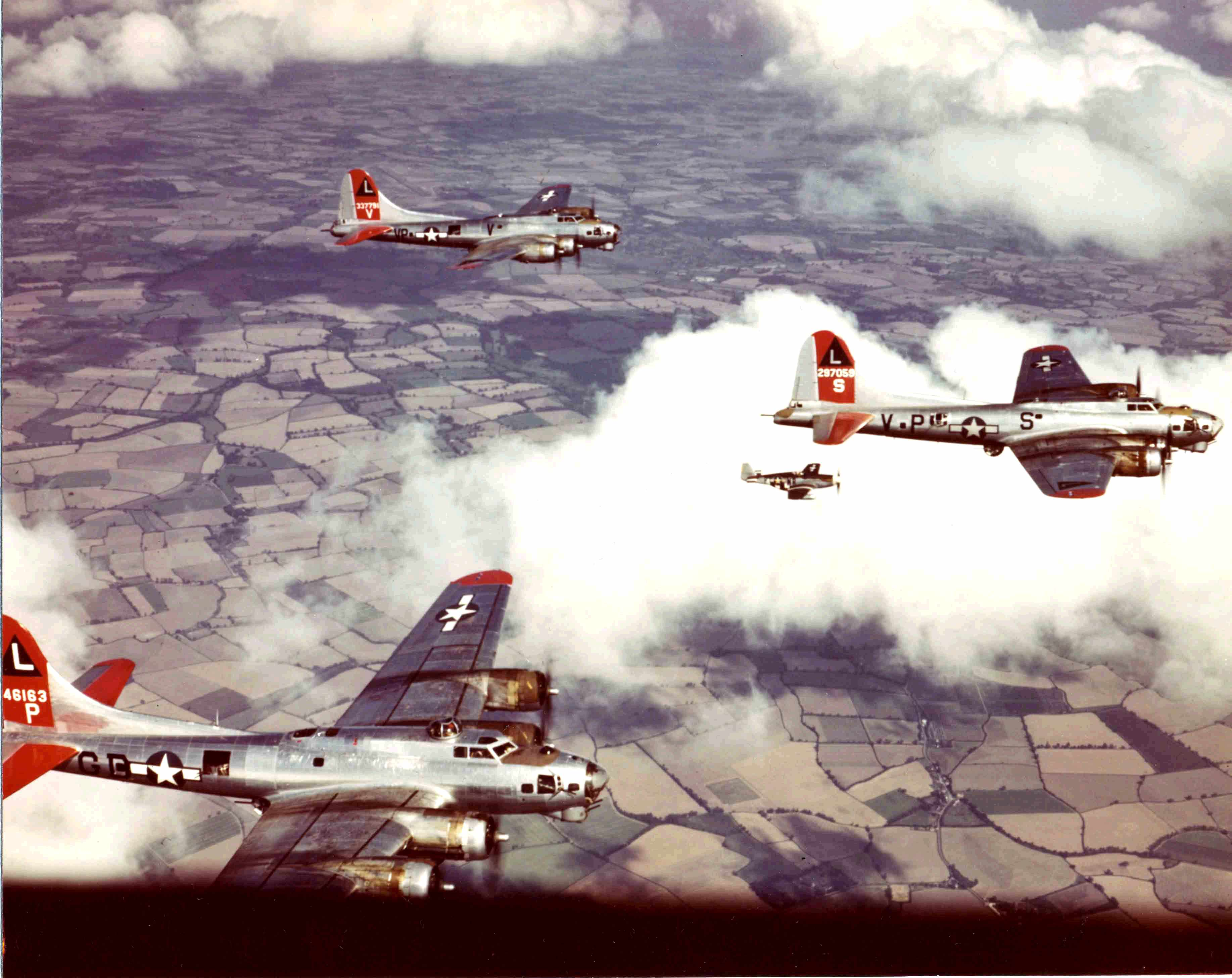 American Flying Fortress bombers and a Mustang fighter practise formation flying over England, training for rain that would help break Nazi resistance. (Photo by PhotoQuest/Getty Images)