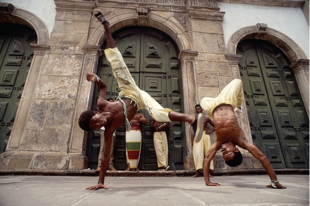 Fight club: Capoeira performers in Salvador, Bahia, eastern Brazil. Originally a fight disguised as a dance, capoeira evolved from practices and rhythms that arrived in Brazil with slaves from Africa. (Picture by Paul Nevin/Getty Images)