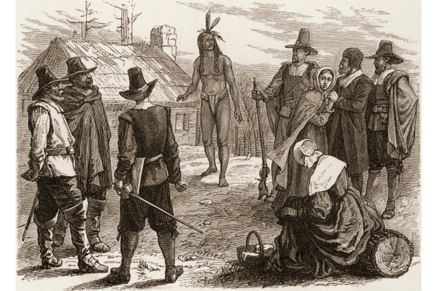 A 19th-century engraving depicts Samoset, a Native American man, as he visits the Pilgrims in Plymouth Colony, Massachusetts, 1621. (Photo by Stock Montage/Getty Images)