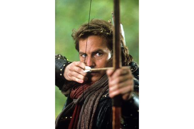 Kevin Costner aiming bow and arrow in a scene from the film 'Robin Hood: Prince Of Thieves', 1991. (Photo by Warner Brothers/Getty Images)