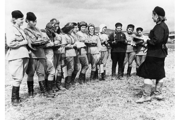 'Night Witches' was a German nickname for the female military aviators of the 588th Night Bomber Regiment, known later as the 46th 'Taman' Guards Night Bomber Aviation Regiment, of the Soviet Air Forces during the Second World War. Here they receive orders for an upcoming raid, c1944. (Photo by Sovfoto/UIG via Getty Images)