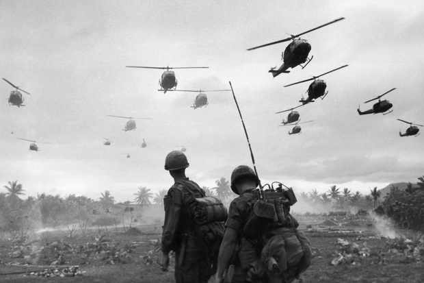 Combat helicopters fly over US troops during a search and destroy mission, South Vietnam. Despite their military might, argues Max Hastings, the Americans were doomed to fail during the Vietnam War. (Photo by Patrick Christain/Getty Images)