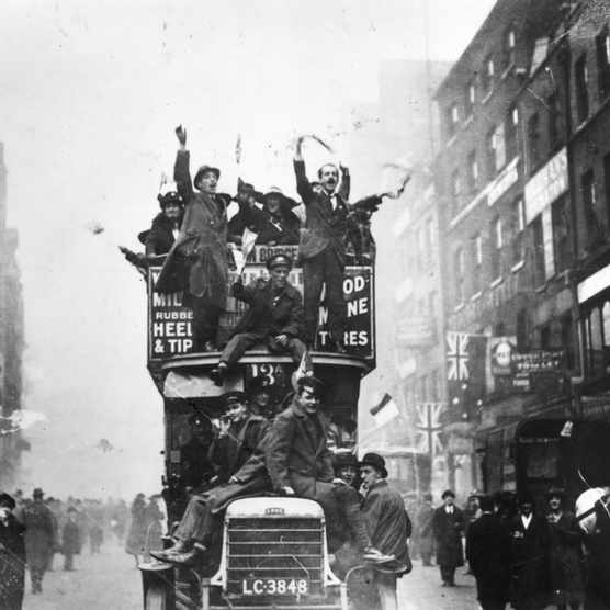 "London crowds celebrating the signing of the armistice at the end of the First World War. ""The armistice brought church services and tears, but it was a day of joy, spontaneity, noise and fun,"" says Guy Cuthbertson. (Photo by Topical Press Agency/Getty Images)"