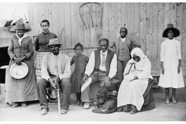 c1900: Harriet Tubman (far left) photographed with members of her family. Tubman is often estimated to have helped to rescue at least 300 people from slavery. (Photo by MPI/Getty Images)