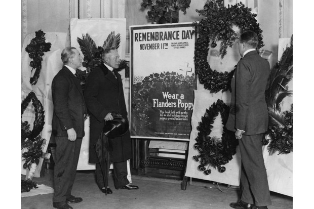 British former field marshal Douglas Haig inspect memorial wreaths before Armistice Day, October 1922. (Photo by Topical Press Agency/Hulton Archive/Getty Images)