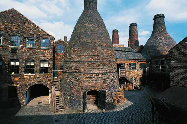 The inner courtyard of the old pottery factory at Gladstone Pottery Museum, with its five towering bottle ovens. (Photo by DeAgostini/Getty Images)